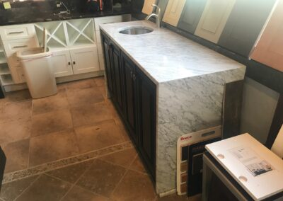 Jim Bishop cabinet with White Carrara Marble Top includes bar sink